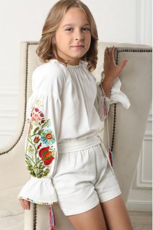 Вишитий комбінезон для дівчинки «Казковий» білого кольору