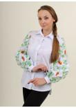 Вишиванка «Нескорена» білого кольору з помаранчевими квітами