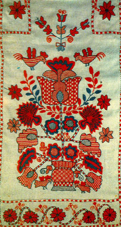 Древо Життя звичайно зображується у вишивках зростаючим з квіткового  горщика - вазона. Цей елемент показує eaab931b33548
